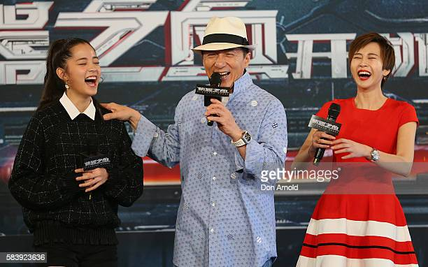 Nana Ouyang and Erica Xiahou shara laugh as Jackie Chan addresses media during a press conference and photocall for Bleeding Steel at Sydney Opera...