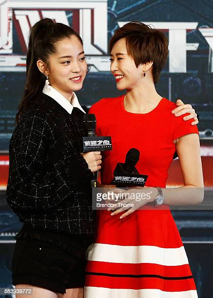 Nana Ouyang and Erica Xiahou share a joke on stage during a press conference and photocall for Bleeding Steel at Sydney Opera House on July 28 2016...