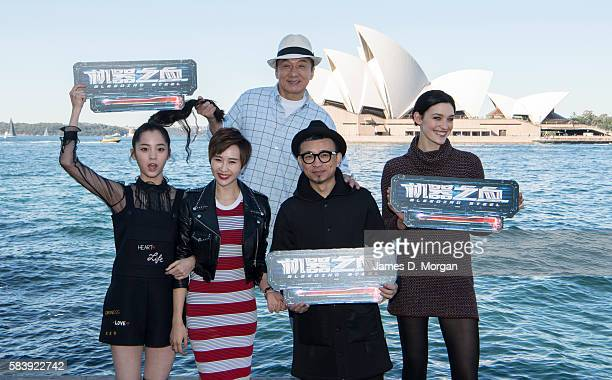 Nana Ouyang Erica XiaHou Jackie Chan director Leo Zhang and Tess Haubrich pose for a group shot while promoting their new film Bleeding Steel at...