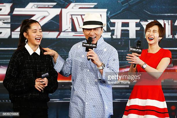 Nana Ouyang Jackie Chan and Erica Xiahou share a joke on stage during a press conference and photocall for Bleeding Steel at Sydney Opera House on...