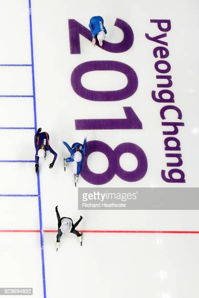 Nana Takagi of Japan crosses the finish line ahead of BoReum Kim of Korea and Irene Schouten of the Netherlands to win the gold medal during the...