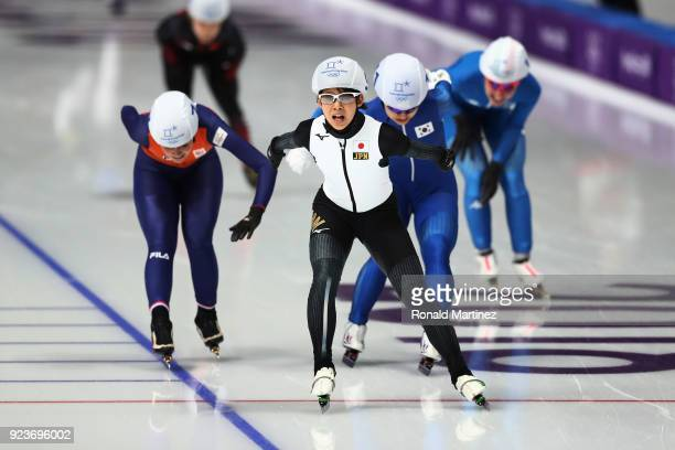 Nana Takagi of Japan crosses the finish line ahead of Bo-Reum Kim of Korea and Irene Schouten of the Netherlands to win the gold medal during the...