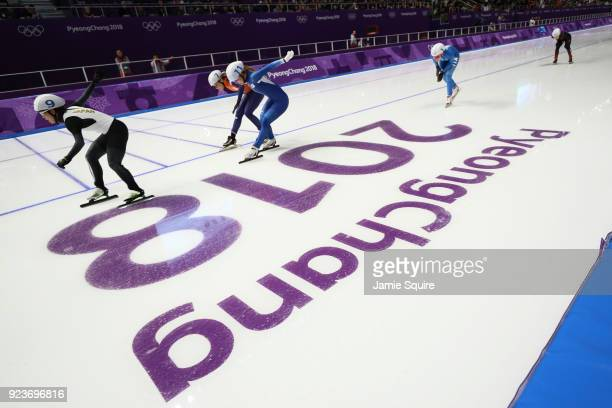 Nana Takagi of Japan races ahead of BoReum Kim of Korea and Irene Schouten of the Netherlands to win the gold medal during the Ladies' Speed Skating...