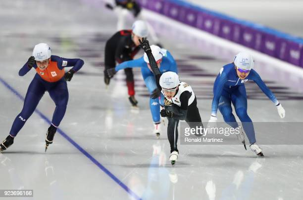 Nana Takagi of Japan races to the finish line ahead of Bo-Reum Kim of Korea and Irene Schouten of the Netherlands to win the gold medal during the...