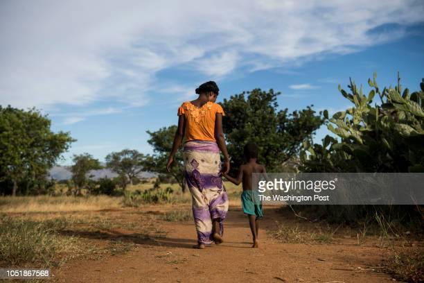Nana walks back to her home in Betsingilo Madagascar with her fiveyearold son on April 7 2018 She has two children and recently got a birth control...