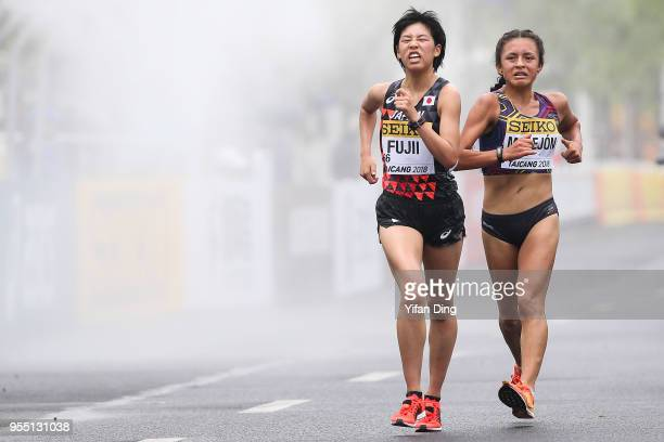 Nanako Fujii of Japan and Glenda Morejon of Ecuador in action during Women's 10 kilometres Race Walk of IAAF World Race Walking Team Championships...
