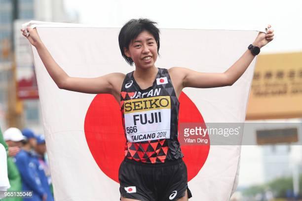 Nanako Fujii of Japan celebrates after finishing as third place during Women's 10 kilometres Race Walk of IAAF World Race Walking Team Championships...