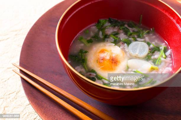 nanakusa gayu, japanese rice porridge with seven spring herbs - mochi stock photos and pictures