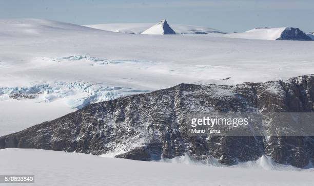 A nanatuk or mountain peak is seen projecting through ice as seen from NASA's Operation IceBridge research aircraft near the coast of the Antarctic...