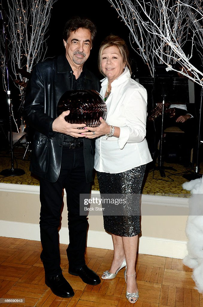Nancee Borgnine honors (L) Joe Mantegna with the 2nd Annual Ernie Award at Borgnine Movie Star Gala at Sportman's Lodge on February 1, 2014 in Studio City, California.