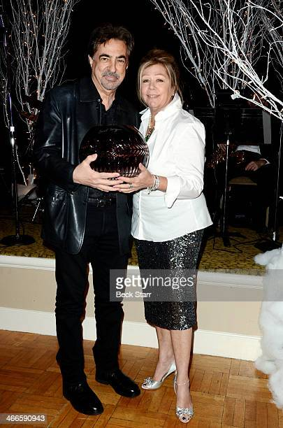 Nancee Borgnine honors Joe Mantegna with the 2nd Annual Ernie Award at Borgnine Movie Star Gala at Sportman's Lodge on February 1 2014 in Studio City...