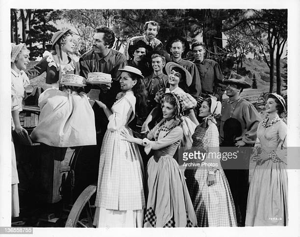 Nancey Kilgas Jane Powell Betty Carr Ruta Kilmonis Julie Newmeyer Virginia Gibson and Norma Doggett as the seven brides and Howard Keel Tommy Rall...