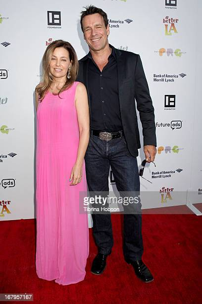 Nanci Chambers and David James Elliott attends a better LA 'An Evening With A View' annual gala at ATT Center on May 2 2013 in Los Angeles California