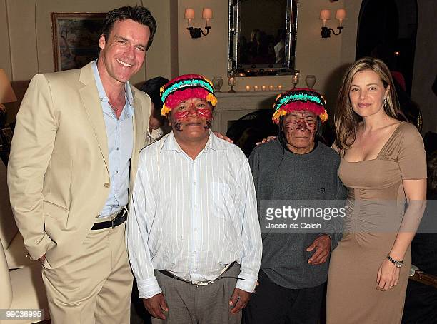 Nanci Chambers and Husband David James Elliott pose for a photo with the Amazon People during the Amazon Watch Fundrasier on May 7 2010 in Los...