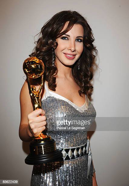Nancy Ajram poses with her award for Middle East arrives at the World Music Awards 2008 at the Monte Carlo Sporting Club on November 9 2008 in Monte...