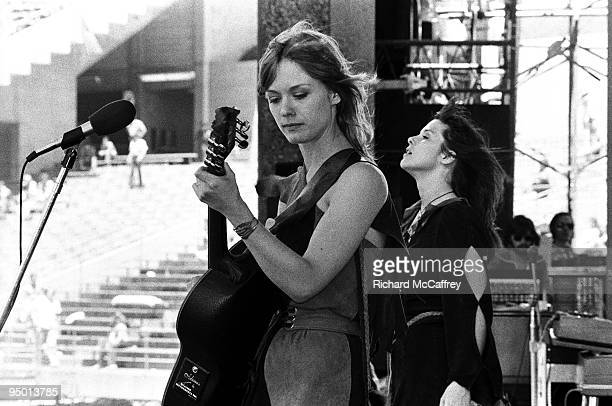 Nancy and Ann Wilson of Heart perform live at The Oakland Coliseum in 1977 in Oakland, California.