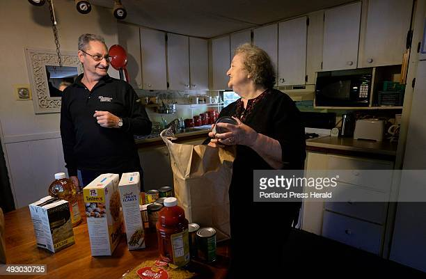 Nancy and Jim Pike talk about the meals they will be able to make with food they received from the Commodity Supplemental Food Program as they unpack...