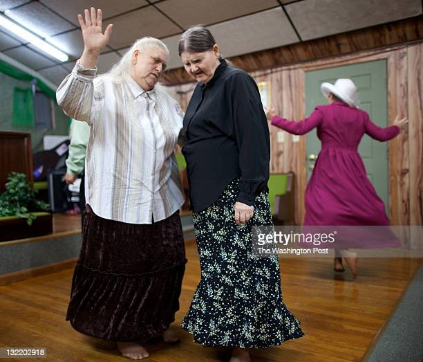 Nancy and Ruth Kennedy dance together during a service at the Church of the Lord Jesus in Jolo West Va on Sept 4 2011 The service was the last of the...