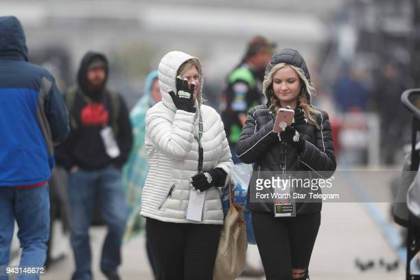 Nancy and Taylor Newell from Chicago walk the pits before the start of the Xfinity Series My Bariatric Solutions 300 at Texas Motor Speedway in Fort...