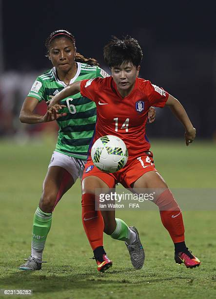 Nancy Antonio of Mexico tries to tackle Kim Soeun of Korea Republic during the FIFA U20 Women's World Cup Group D match between Mexico and Korea...
