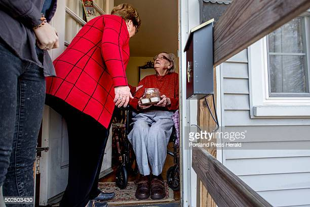Nancy Brennerman center chats with Josephine Hayward of Portland after delivering a meal to Hayward as part of the Southern Maine Agency on Aging's...