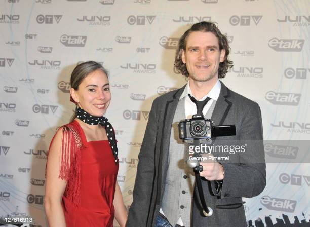 Nancy Cardwell and singer Jesse Cook pose on the red carpet at the 2011 Juno Awards at the Air Canada Centre on March 27 2011 in Toronto Canada