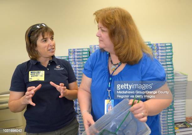 Nancy Caruso a marine biologist and founder of Get Inspired chats with science teacher Sharna Murphy in the aquaponics lab at Millikan High School in...