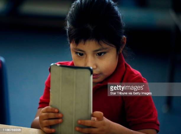 Nancy ChaucaMacancela a first grader read from her ipad during class Thursday at Risen Christ School January 22 2015 Minneapolis MN] Jerry Holt/...