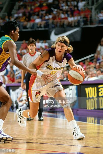 Nancy Cline of the Phoenix Mercury drives to the basket against the Los Angeles Sparks during a game at America West Arena on December 301997 in...