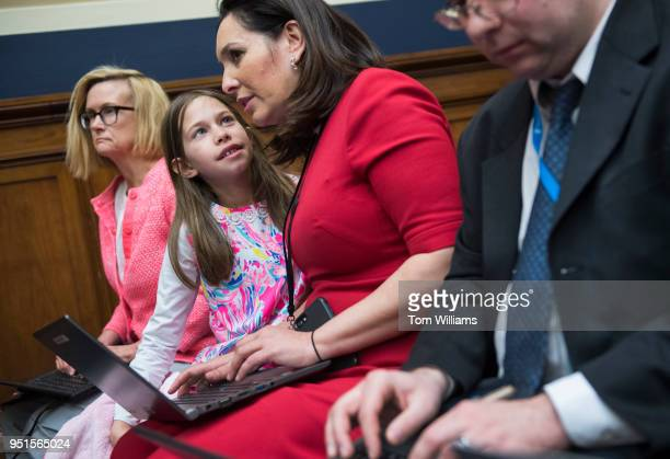 Nancy Cordes of CBS News and her daughter Lila listen to testimony by EPA Director Scott Pruitt on Take Our Daughters and Sons to Work Day during a...