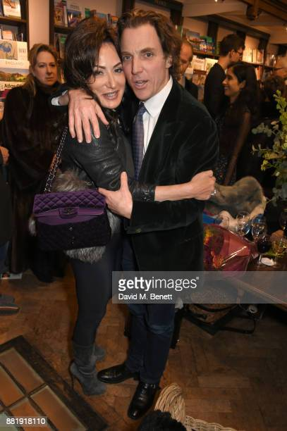 Nancy Dell'Olio and Alexander Newley attend the launch of new book 'Unaccompanied Minor' by Alexander Newley at Daunt Books on November 29 2017 in...