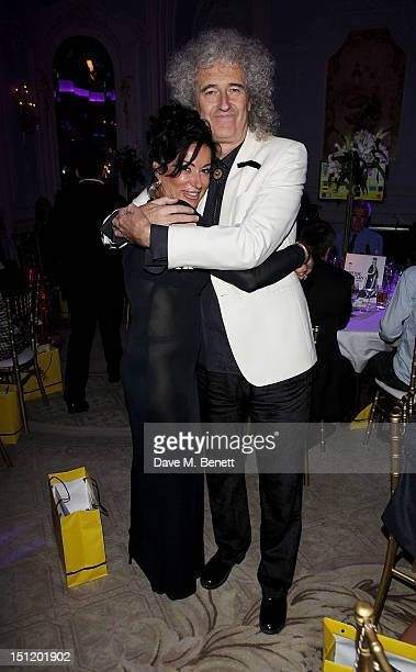 Nancy Dell'Olio and Brian May attend the second annual 'Freddie For A Day' event in memory of Queen's late frontman Freddie Mercury at The Savoy...
