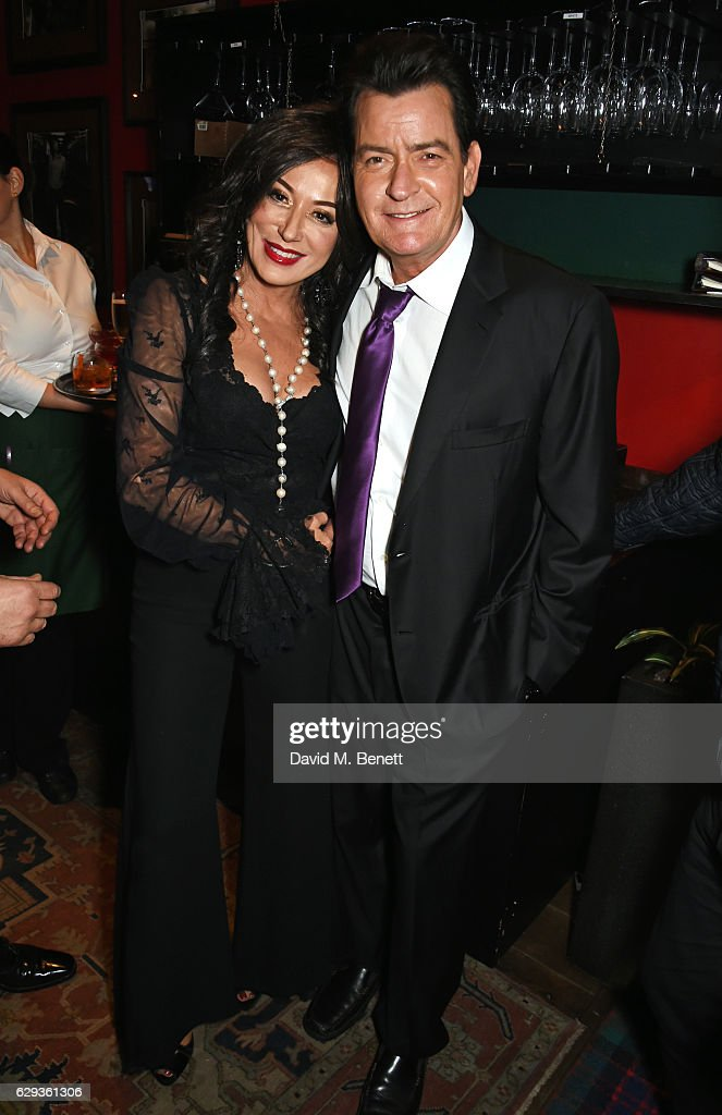 Nancy Dell'Olio (L) and Charlie Sheen attend the Snow Queen Cigar Smoker of the Year awards at Boisdale of Canary Wharf on December 12, 2016 in London, England.