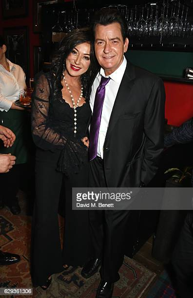 Nancy Dell'Olio and Charlie Sheen attend the Snow Queen Cigar Smoker of the Year awards at Boisdale of Canary Wharf on December 12 2016 in London...