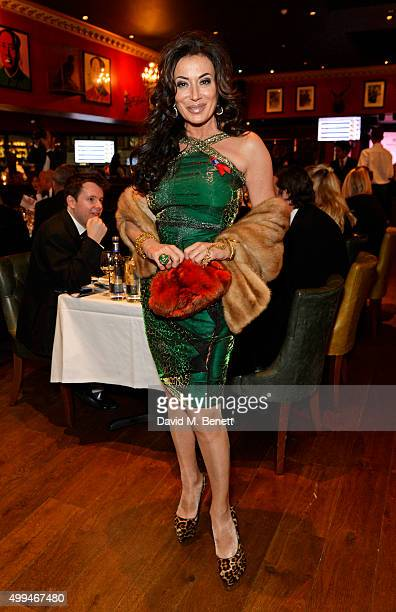 Nancy Dell'Olio attends The Snow Queen Cigar Smoker of the Year Awards Dinner 2015 at Boisdale Canary Wharf on December 1 2015 in London England