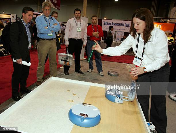 Nancy Dussault from irobot Corp spills coffee to demonstrate the irobot Scooba at the International Consumer Electronics Show January 6 2006 in Las...