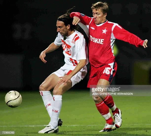 Nancy's Frederic Biancalani fights for the ball with Wisla Krakow's Jakub Blaszczykowski during UEFA football match Nancy vs Wisl Cracovie at Marcel...