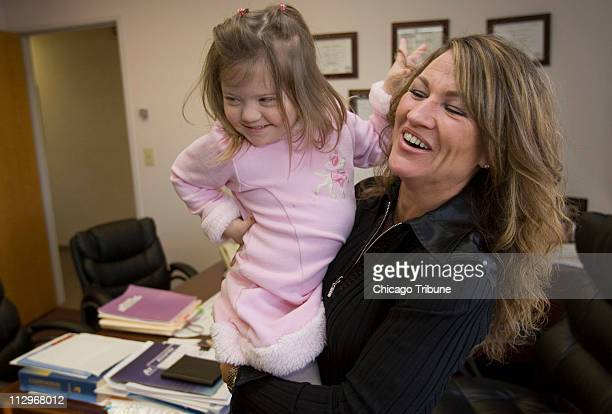Nancy Gianni right and 4yearold daughter Gigi play as they visit Dr Ravi Trivedi's office January 9 in Hoffman Estates Illinois Gianni is the founder...
