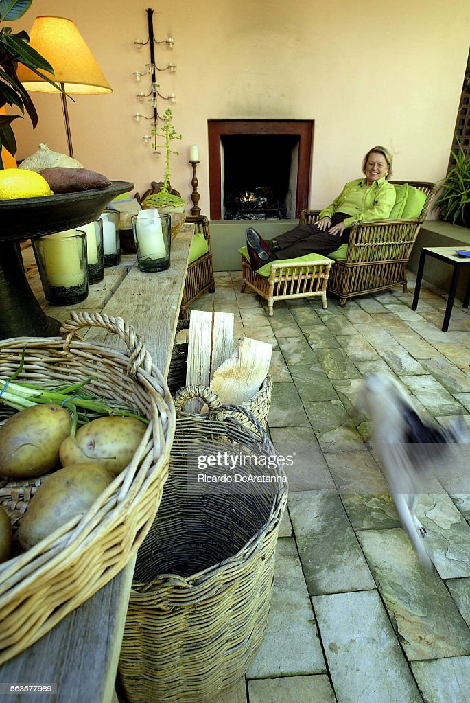 Nancy Goslee Power sitting by fireplace in courtyard of her Santa Monica home . She is the city