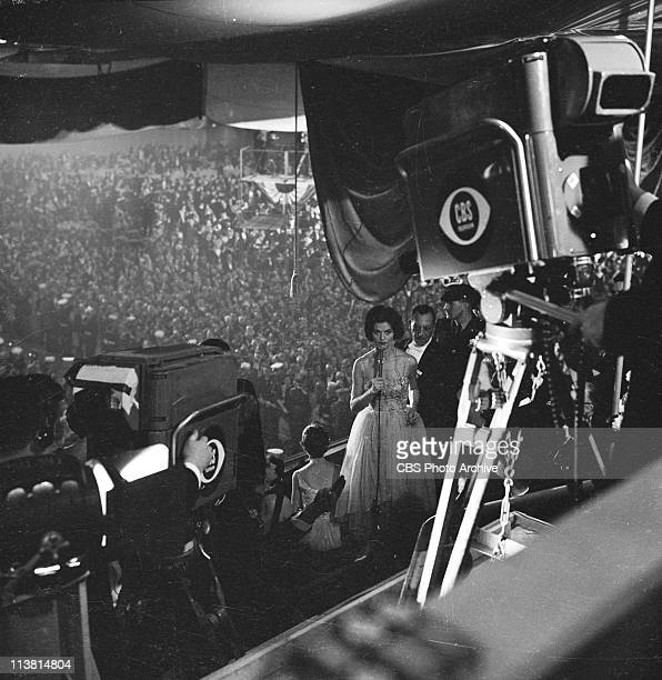Nancy Hanschman Dickerson, first female reporter for CBS, reporting from John F. Kennedy's Inauguration Ball, January 20, 1961.