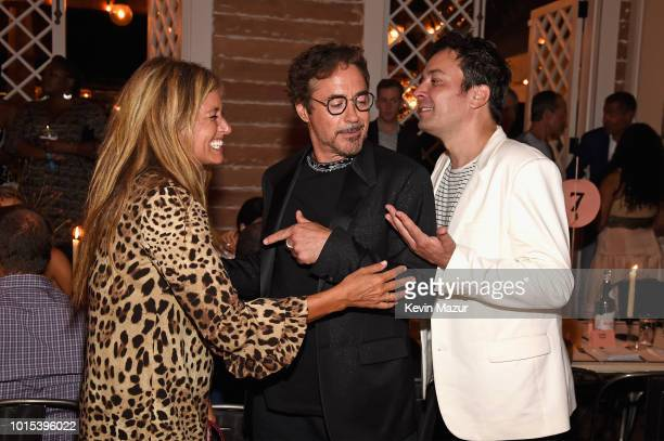 Nancy Juvonen Robert Downey Jr and Jimmy Fallon attend Apollo in the Hamptons 2018 Hosted by Ronald O Perelman at The Creeks on August 11 2018 in...