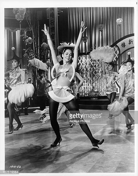 Nancy Kwan dancing in a scene from the film 'Flower Drum Song' 1961
