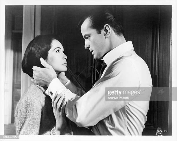 Nancy Kwan looks to Robert Goulet in a scene from the film 'Honeymoon Hotel' 1964