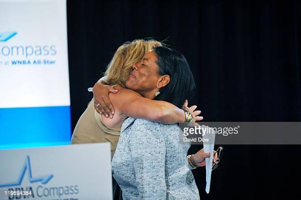 Nancy Liberman hugs WNBA President Laurel Richie during the BBVA Compass Luncheon as part of the 2011 WNBA Cares Community Caravan at The Terrance at...