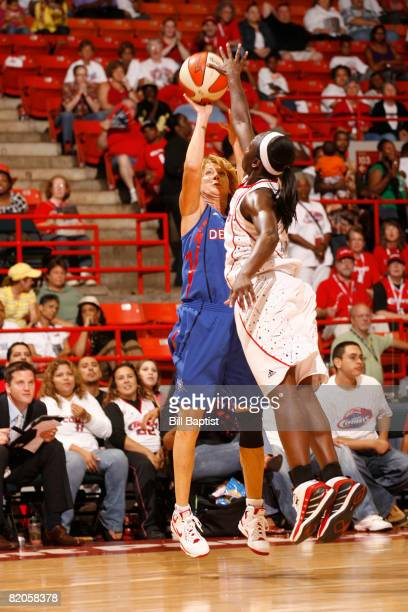 Nancy Lieberman of the Detroit Shock shoots the ball over Matee Ajavon of the Houston Comets at Reliant Arena July 24 2008 in Houston Texas NOTE TO...