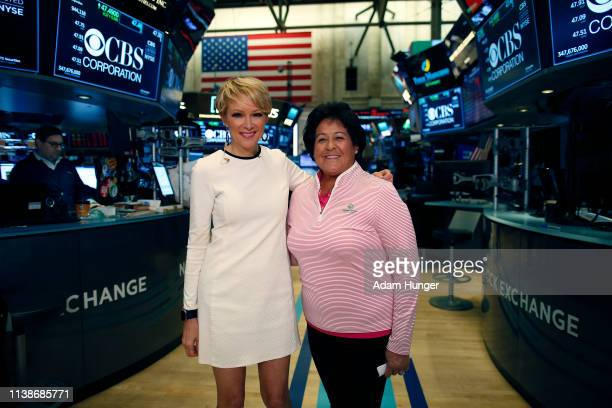 Nancy Lopez and Gerri Willis pose for a picture at the New York Stock Exchange for the Augusta National Women's Amateur press tour on March 27 2019...