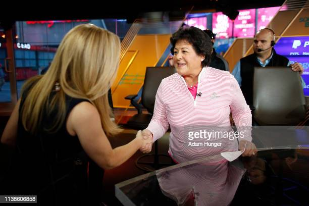 Nancy Lopez shakes hands with Rebecca Quick just before the CNBC interview in Times Square for the Augusta National Women's Amateur press tour on...