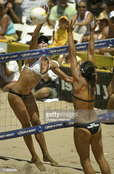 Nancy Mason hits the ball against Misty MayTreanor during the AVP Manhattan Beach Open final match on August 12 2006 in Manhattan Beach California...