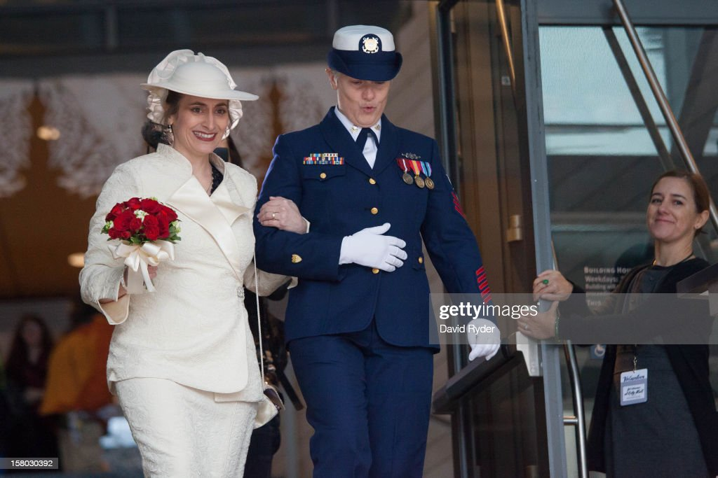 Nancy Monahan, right, a retired Coast Guard petty officer, takes a deep breath while receiving cheers from the crowd as she exits City Hall with her wife, Deb Needham, after their wedding on December 9, 2012 in Seattle, Washington. Today is the first day that same-sex couples can legally wed in Washington state.