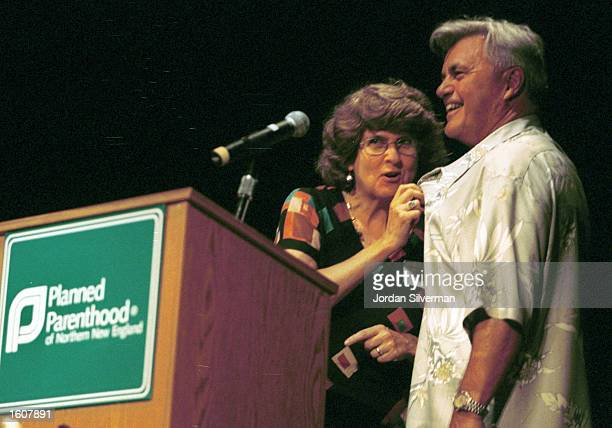 Nancy Mosher President and CEO of Planned Parenthood of Northern New England speaks through the mic clipped to author John Irving''s shirt August 7...